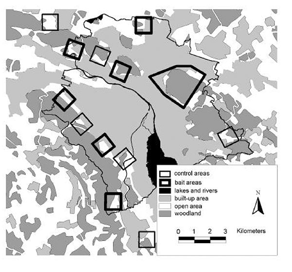 Study area of the controlled anthelmintic baiting experiment in the conurbation of the city of Zürich. 50 Praziquantel-containing baits per km2 were delivered monthly in six 1-km2 bait areas and one 6-km2 bait area, that alternated along the urban fringe with six control areas. Black line, Zürich border.