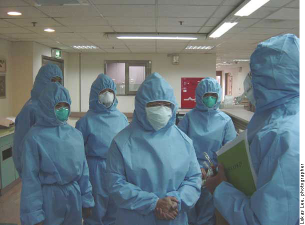 Hospital workers in Kaohsiung, Taiwan listen to a summary of findings from walkthrough survey and pressurization testing on a severe acute respiratory syndrome patient ward.