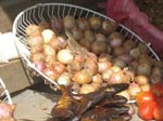 Thumbnail of Photograph taken at a local street market in Gabon shows a lizard in a basket of onions, which are frequently eaten uncooked. Salmonella enterica subspecies enterica serotype Agama has been isolated from lizards in Africa.