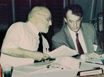 Thumbnail of Institute of Medicine co-chair Joshua Lederberg (left) in conversation with James M. Hughes, director, National Center for Infectious Diseases, Centers for Disease Control and Prevention (CDC), during a meeting in 1993 with expert consultants on development of the first CDC emerging infectious disease strategy.