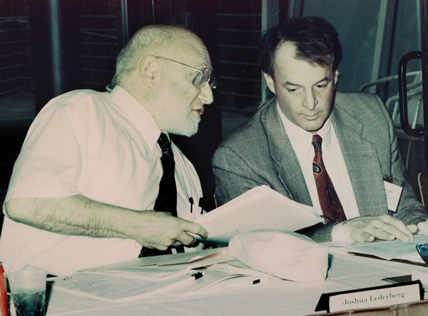 Institute of Medicine co-chair Joshua Lederberg (left) in conversation with James M. Hughes, director, National Center for Infectious Diseases, Centers for Disease Control and Prevention (CDC), during a meeting in 1993 with expert consultants on development of the first CDC emerging infectious disease strategy.