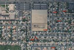 Thumbnail of Aerial photograph of a representative Bakersfield, California, neighborhood taken during August 2007. Red arrows indicate neglected or green swimming pools. Letters (F, G, H, J) are photographic reference points.