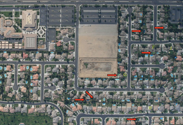 Aerial photograph of a representative Bakersfield, California, neighborhood taken during August 2007. Red arrows indicate neglected or green swimming pools. Letters (F, G, H, J) are photographic reference points.