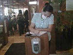 Thumbnail of A reopened restaurant in Mexico City, Mexico, illustrating mask use by the person greeting entering customers and a hand hygiene dispenser that all entering customers were required to use, May 2009. Photo courtesy of Carlos del Rio.