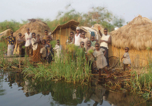 Fishing camp on an island in Lake Upemba, upper Congo River Basin. Fishermen and their families usually spend several weeks every year in camps like this, in which the lake is the only source of water. Because there is no firewood in such areas, campaigns promoting the boiling of water are useless. (Photograph by Didier Bompangue.)