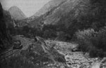 Thumbnail of Railway construction at base of the Devil's Nose switchbacks, Ecuador, showing railway on the left and stone-lined riverbed on the right, where several pools can be seen (likely formed by falling rocks from construction), which would likely have provided suitable habitat for Anopheles pseudopunctipennis larvae. Photograph: Historical Archive of Banco Central and García Idrovo (14).