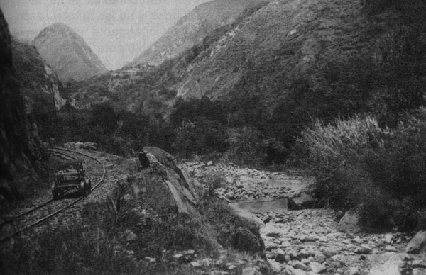 Railway construction at base of the Devil's Nose switchbacks, Ecuador, showing railway on the left and stone-lined riverbed on the right, where several pools can be seen (likely formed by falling rocks from construction), which would likely have provided suitable habitat for Anopheles pseudopunctipennis larvae. Photograph: Historical Archive of Banco Central and García Idrovo (14).