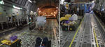 Thumbnail of Demarcation of clean and dirty zones during use of the Trexler Air Transportable Isolator patient transport system on a Boeing C-17 Globemaster transport aircraft. A) Yellow lines clearly demarcate clean and dirty zones as required for transporting both confirmed and exposed viral hemorrhagic fever case-patients. B) For exposed patients, the demarcation zone should extend to a corridor leading to isolated toileting and comfort facilities.