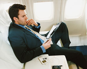 man in suit on plane