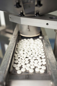 Pills being manufactured