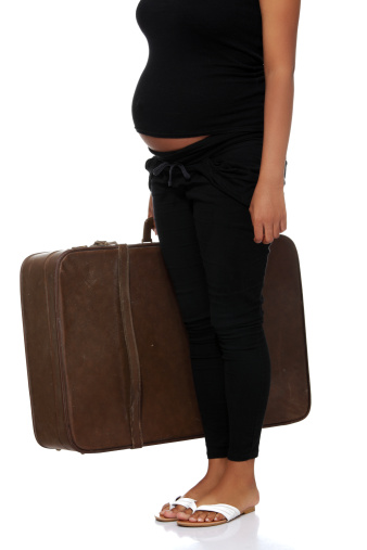 pregnant woman with suitcase